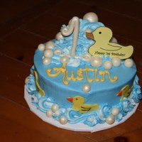 "Rubber Ducky First Birthday  Fondant Rubber Ducks made with cookie cutter. Bubbles and ""1"" were painted with pearl dust. The waves behind the topper is..."