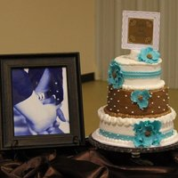Turquoise And Brown! Turquoise and brown tiered bridal cake. Iced in BC with fondant accents.
