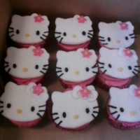 1321556517.jpg Hello Kitty Cup cakes maked out of fondant.