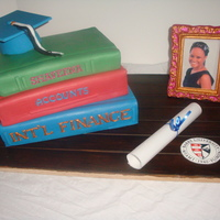 Book Graduation Cake Book Graduation cake - The cap, wood & books are covered in fondant, the diploma is rice paper (edible) the pic frame is made of white...