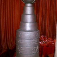 Stanley Cup Wedding  Stanley Cup 7 tier wedding cake, red velvet, silver sprayed fondant with silver chefmaster spray- took 4 cans, top done in dummy sphere and...