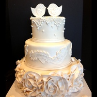 Love Bird Wedding Cake   ivory, love bird, rosettes, fondant frills, lace and beads