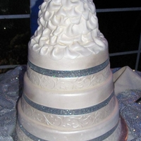 Wedding Dress Cake  I made my own wedding cake and this is it!, fondant all around, silver bling ribbon, swirl fondx wrapping..i would not suggest for anyone...