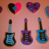 Rock Star Cookies Sugar cookies in guitar, star and heart shapes covered in fondant and decorated in sprinkles.