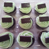 Chocolate Mint Cupcake Chocolate cupcake dipped in chocolate ganache, topped with mint buttercream and garnished with an Andes mint.