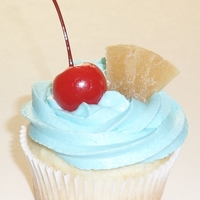 Blue Hawaiian Cupcake Blue Hawaiian Cupcake: Pineapple rum cake, filled with a homemade pineapple curd filling, topped with Blue Curacao Rum frosting!!!! That&#...