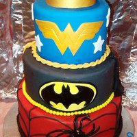 "Wonderwoman/batman/spiderman  Chocolate cake. 10"", 8"" and 6"" (dummy) Enjoyed making this with a little help from my friends (CCers) and the interenet. I..."