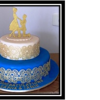 Engagement Cake Engagement cake. I made the gold edible lace for the first time. It was quite easy to make. I had to use R.I. to adhere it on the cake....