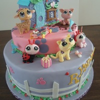Littlest Pet Shop Cake   All made of fondant, everything is edible, including the pets and the little house