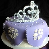 "Sofia The First. Sofia the First inspired with royal icing tiara and fondant ""dress""."