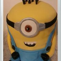 Minion   *Fondant covered minion on rainbow cakes.
