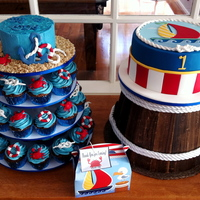 Nautical First Birthday A nautical themed birthday with all chocolate mud cupcakes, smash cake and main cutting cake. Decorated to match the invitations.