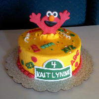 Surprise...it's Me Elmo!!! Buttercream with modeling chocolate elmo. Inspiration from Tracij here on cc