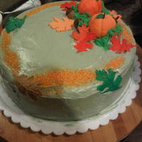 Thanksgiving Fall Cake Fondant pumpkin and leaves with sprinkles of suger.
