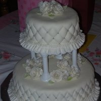 Rose Anniversary Cake white gumpaste roses with silver shimmer dust for grandparents anniversary. they never had a wedding cake so i made this for them