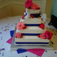 Blue And Pink Wedding Cake   Fresh flowers.