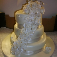 Ivory Wedding Cake ivory cake with cascading roses