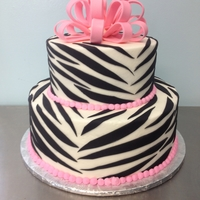 Zebra Print Cake Iced in buttercream with fondant zebra stripes and a fondant bow