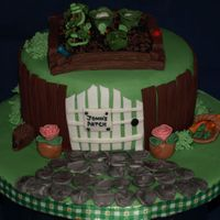 Johns Patch   Small fondant covered rich fruit cake with a vegetable patch on top and general garden theme .