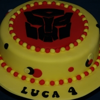 Transformers Cake Fondant covered sponge cake with Transformers theme . Face hand cut from fondant