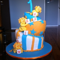 Lion Themed Cake   Lion themed first birthday cake with cookies to match