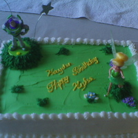 Buzz And Tinkerbell Cake This cake was done for my friend. It has both buzz and tink on it because it was for both of her children. It is a marble cake with...