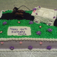 Nora's 90Th Birthday This is a marble cake with buttercream icing. The carriage is made of graham crackers and royal icing. The trail is made of oreo cookie...