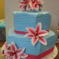 Tropical Blue And Hot Pink Almond Hexagon Cake filled with Satin Whip and Fresh Strawberries.