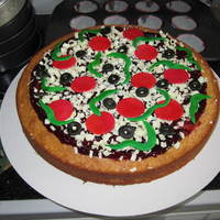 "Dessert Pizza Rich butter cake topped with Raspberry Sauce and fondant ""toppings"""