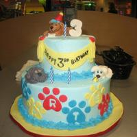 Puppy Party *2 tier cake, 6 inch and 10 inch. Iced in buttercream with fondant decorations