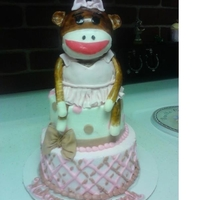 Sock Monkey Sock monkey was made from RKT and covered in fondant. Cake is iced in butterceam with fondant decorations. TFL