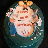 Aunty Margaret Birthday Oval Rich Fruit Cake covered in fondant with gum paste trophy, golf and tennis pieces