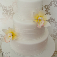 Yellow Orchid Wedding Cake I threw this together in a rush as I needed another dummy cake for a wedding fayre in February. I wanted something simple and sunny and...