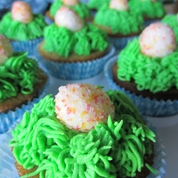 Easter Egg Cupcakes Vanilla cupcake with a fondant egg rolled in multi colored sugar crystals.