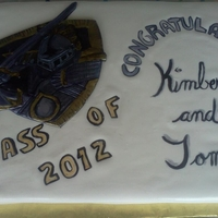East Ridge Knights Graduation Cake Vanilla Cake with Cinnabon Butter cream. Covered in fondant, hand painted knight