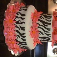 Zebra Bday Cake is a butter cake with butter cream frosting covered in fondant. Daisy's and bow are also fondant. Hand painted the zebra stripes...