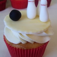Bowling Cupcakes 12 French vanilla and 12 chocolate fudge cupcakes. Fondant bowling toppers base painted to resemble a bowling lane, as well as letters to...