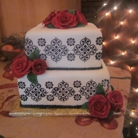 Black White And Red Wedding Cake Square two tier wedding cake with black royal icing stenciling. Red sugar roses.
