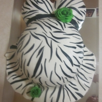 Safari Themed Belly Cake   Baby Shower Belly Cake with zebra print and green sugar roses