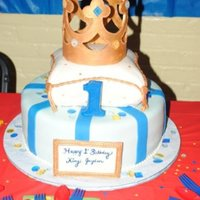 King Pillow Cake 1st Birthday cake. Round tier with pillow cake on top with king's crown. WASC cake with vanilla and chocolate custard filling. Crown...