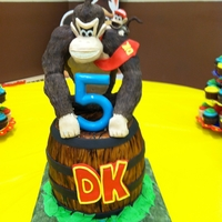 Donkey Kong Cake Donkey Kong cake with JR on his shoulder. Barrel is cake and Donkey Kong is RKT.