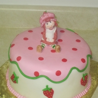 Strawberry Shortcake Cake   Strawberry Shortcake Cake with edible hand modeled strawberry shortcake doll.