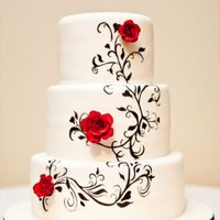 Hand Painted Black And White Wedding Cake   Fondant covered cake with hand painted design and gum paste roses.