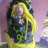 Rapunzel  My daughter wanted Rapunzel for her birthday cake. The cake had to have a big tower! Here it is all edible. This is the first time I made a...