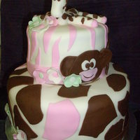Jungle Jill Themed Bedding WASC and Chocolate cake with Cream Cheese icing and covered in fondant.