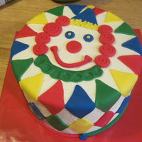 Clown Cake Clown cake for a precious 1 year old! I wanted a fun clown, not a creepy one with bright primary colors. Fun to make. Vanilla cake with...