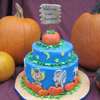 It's The Great Pumpkin Charlie Brown! Chocolate Pumpkin Swirl cake with buttercream frosting and fondant decorations. Large pumpkin on top is Rice Krispie Treats. Saw this on...