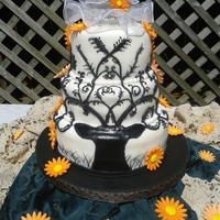 Elegant Deer Wedding Cake  Yes, elegant and deer can go together. My niece wanted camo and I wouldn't let her do it. I finally convinced her to replicate the...