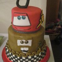 "Lightning And Mater Large cake to feed 70. 10 inch bottom single layer tier and top 6"" inch tier were both strawberry cake. Middle 8"" tier was..."