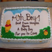 Winnie The Pooh Baby Shower chocolate cake, buttercream frosting. Cricut cake machine to cut out the pooh and honey pot. Fondant bees with rice paper wings and...